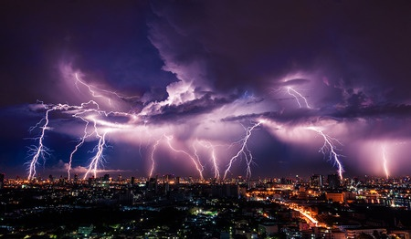 40609402 - lightning storm over city in purple light