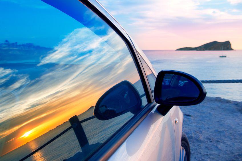 11191229 - ibiza cala conta conmte susnset reflection y car window glass