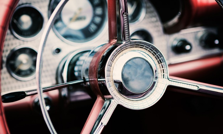 52546833 - classic car with close-up on steering wheel