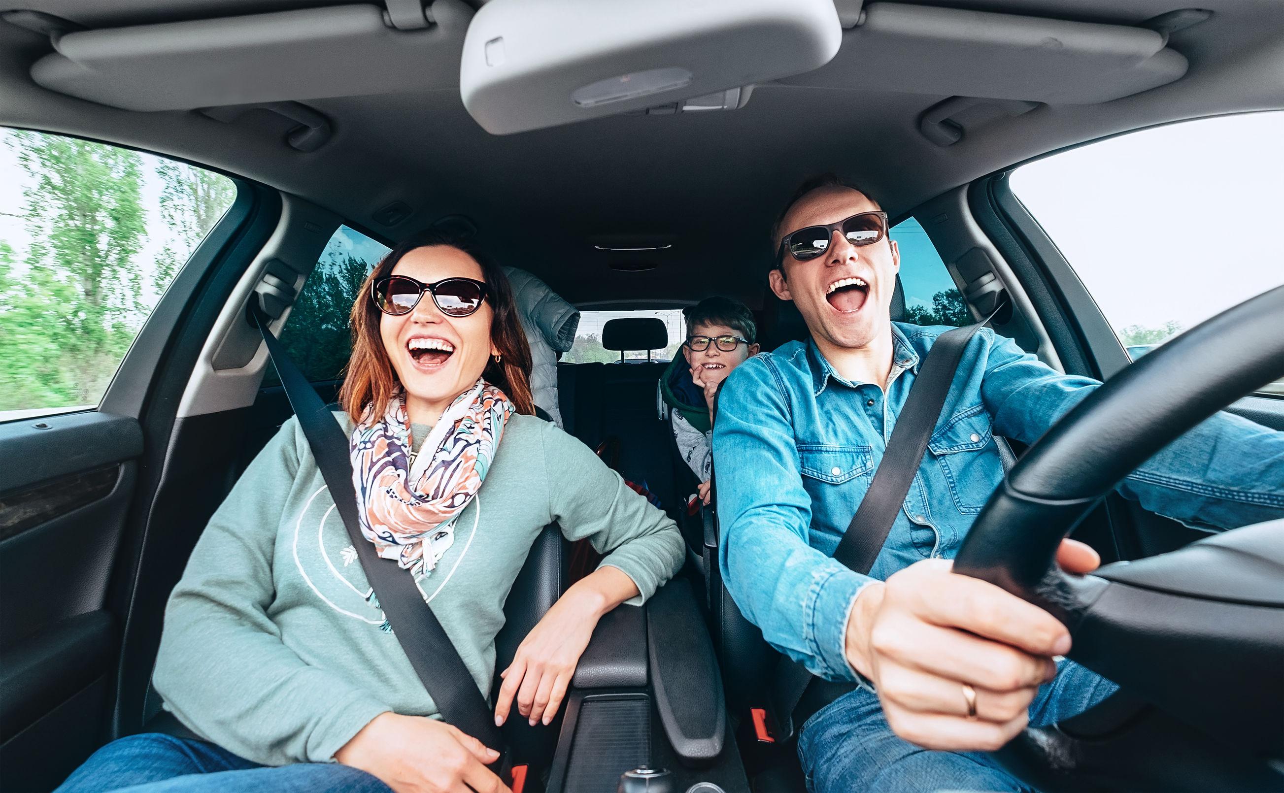 Singing family in car
